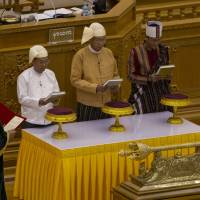 In 'historic moment,' Suu Kyi confidant takes over as new Myanmar president