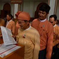 National League for Democracy lawmakers arrive at the Myanmar parliament for the historic presidential vote on Tuesday. It confirmed that Htin Kyaw, a writer and longtime friend of Aung San Suu Kyi, will become the nation's first civilian leader in decades.   AFP-JIJI