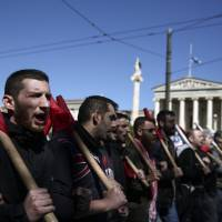 Supporters of the communist-affiliated union PAME shout slogans during an anti-NATO rally in Athens, on Saturday. Thousands of protesters marched to the offices of the European Union in the Greek capital opposing the deployment of NATO naval force in the Aegean Sea, between Turkey and Greece. | AP