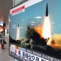 A TV screen shows a file footage of a missile launch conducted by North Korea, at Seoul Railway Station in Seoul, on Thursday. | AP