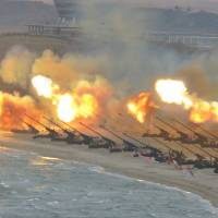 This undated picture released Saturday from North Korea's official Korean Central News Agency shows the large-scale intensive striking drill of long-range artillery pieces of the KPA large combined units at an undisclosed location in North Korea. | AFP-JIJI / KCNA VIA KNS