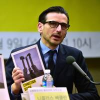 Amnesty International's East Asia regional director Nicholas Bequelin speaks during a Wednesday news conference in Seoul on restrictions to mobile phones and outside information in North Korea. | AFP-JIJI