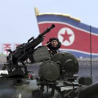 A North Korean tank commander salutes during a parade through Kim Il Sung Square in Pyongyang in this 2013 file image. | AP