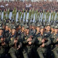 North Korean soldiers parade on Kim Il Sung Square in Pyongyang on Oct. 10. | AP
