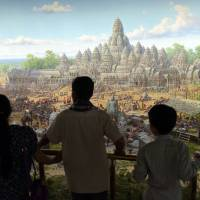 Visitors look at a painting at the Angkor Panorama Museum in Siem Reap province on Feb. 16. | AFP-JIJI