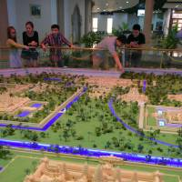 Visitors look at Angkor Wat temples models at the Angkor Panorama Museum in Siem Reap province on Feb. 16. | AFP-JIJI