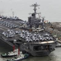 The Nimitz-class aircraft carrier USS John C. Stennis arrives in Busan, South Korea, on Sunday, ahead of the annual Key Resolve military exercise conducted by South Korean and U.S. forces. | REUTERS