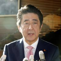 Prime Minister Shinzo Abe speaks to reporters Friday morning after North Korea's reported firing of a ballistic missile. | KYODO