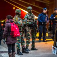 Soldiers stand guard at the entrance of the closed De Brouckere metro stationThursday in Brussels, two days after a triple bomb attack, claimed by the Islamic State group, hit Brussels' airport and the Maelbeek — Maalbeek subway station, killing 31 people and wounding 300 others.   AFP-JIJI