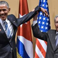 Obama, Castro hold historic Havana talks, air gripes but look forward
