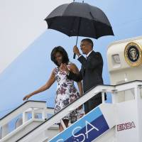 U.S. President Barack Obama and his wife, Michelle, exit Air Force One as they arrive at Havana's international airport for a three-day trip Sunday. | REUTERS