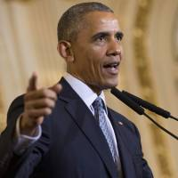 President Barack Obama answer a question about the recent attack in Brussels during a joint news conference with Argentine President Mauricio Macri, Wednesday at the Casa Rasada in Buenos Aires. | AP