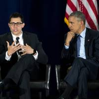 President Barack Obama listens as Young People in Recovery President and CEO Justin Riley speaks during a panel discussion at the National Rx Drug Abuse and Heroin Summit Tuesday in Atlanta.   AP