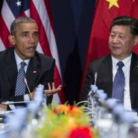 President Barack Obama meets with Chinese President Xi Jinping in Le Bourget, France, last November. | AP