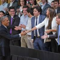 President Barack Obama meeta a guest as he is introduced for a town hall meeting with local Argentinians at the Usina del Arte, Wednesday in Buenos Aires. | AP