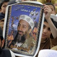 Protesters carry a portrait of slain al-Qaida leader Osama bin Laden at a 2012 anti-U.S. rally in Quetta, Pakistan, on the first anniversary of his death. | AFP-JIJI