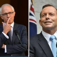 Australian leader clashes with predecessor over record