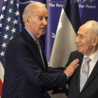 Former Israeli President Shimon Peres (right) and U.S. Vice President Joe Biden interact during their meeting at the Peres Center for Peace in Jaffa. Israel, Tuesday. | AP