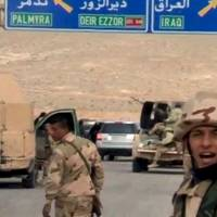 Forces loyal to Syrian President Bashar Assad gesture as they advance into the historic city of Palmyra in this picture provided by SANA on Thursday.   REUTERS / SANA / HANDOUT VIA REUTERS