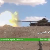 A tank fires at where the Syrian military media said is Palmyra, in this still image taken from a Syrian military media video uploaded on Wednesday.   REUTERS / SYRIAN MILITARY MEDIA VIA REUTERS