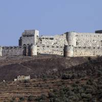 Syria's 12th century Krak des Chevaliers castle in the Homs region is seen in 2014. Three-dimensional reconstructions of some of Syria's most spectacular archaeological sites go online Tuesday after a big push to digitize the war-torn country's threatened heritage. | AFP-JIJI