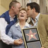 Award-winning actress Patty Duke receives a kiss from sons, MacKenzie (left) and Sean Astin, following an unveiling ceremony honoring Duke with the 2,260th star on the Hollywood Walk of Fame in Los Angeles in 2004. Duke has passed away at the age of 69, according to news reports. | REUTERS
