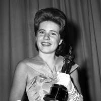 Patty Duke, named best supporting actress of the year for her role in 'The Miracle Worker,' poses with her award after the Academy Award ceremony in Santa Monica, California, in 1963. Duke, who won an Oscar as a child at the start of an acting career that continued through her adulthood, died Tuesday of sepsis from a ruptured intestine. She was 69. | AP