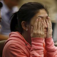 Maia Santos Deguito, branch manager of the Rizal Commercial Banking Corp (RCBC), rubs her eyes as she testifies during a Senate hearing of money laundering involving the theft of $81 million from the U.S. account of the Bangladesh Bank, at the Philippine Senate in Manila on March 17. | REUTERS