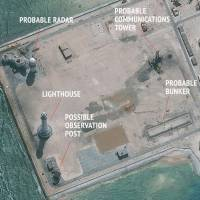An annotated satellite image released on Feb. 23 shows construction of possible radar facilities in the Spratly Islands in the South China Sea. | CSIS/DIGITALGLOBE