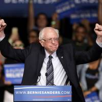 Sanders is surprise victor in Michigan; Trump keeps winning