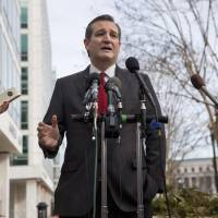 Republican presidential candidate Sen. Ted Cruz speaks to the media about events in Brussels Tuesday near the Capitol in Washington. Cruz said he would use the 'full force and fury' of the U.S. military to defeat the Islamic State group.   AP
