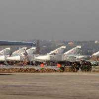 Russian fighter jets sit on the tarmac at the Russian Hmeimim military base in Latakia province, in the northwest of Syria, on Feb. 16. | AFP-JIJI