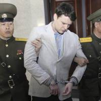 American student Otto Warmbier is escorted at the Supreme Court in Pyongyang Wednesday. North Korea's highest court sentenced Warmbier, a 21-year-old University of Virginia undergraduate student, from Wyoming, Ohio, to 15 years in prison with hard labor on Wednesday for subversion. He allegedly attempted to steal a propaganda banner from a restricted area of his hotel at the request of an acquaintance who wanted to hang it in her church. | AP