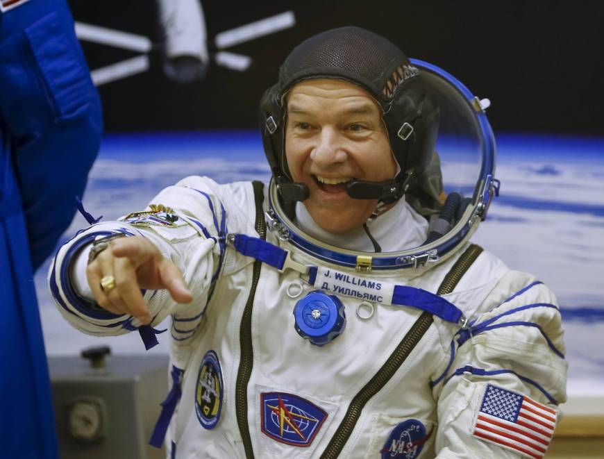 Rocket carrying Russian cosmonauts, U.S. grandpa astronaut heads to ISS