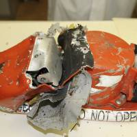 Russian officials pull data from crashed 737's voice recorder; Rostov airport reopens