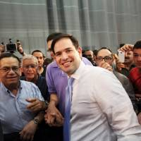 Republican U.S. presidential candidate Florida Sen. Marco Rubio meets with supporters while campaigning in Toa Baja, Puerto Rico, Saturday. | REUTERS