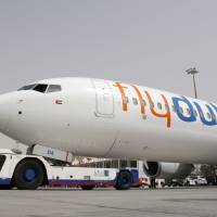 The first of FlyDubai's 50 Boeing 737-800 aircraft sits on the tarmac at Dubai airport in May 2009. | AFP-JIJI