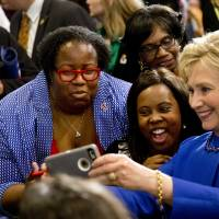 Democratic presidential candidate Hillary Clinton takes pictures with supporters after a Feb. 23 campaign event in Columbia, South Carolina. | AP