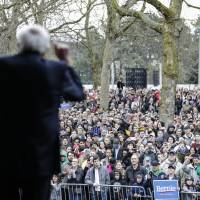 Democratic presidential candidate Sen. Bernie Sanders speaks to a crowd on March 20 ahead of a campaign rally in Seattle. | AP