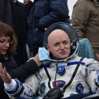 Life back on Earth not yet a drag as yearlong spacemen embrace blast of fresh, frigid air