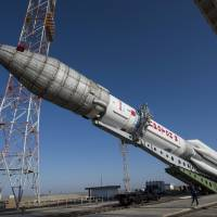 A Proton rocket that will launch the ExoMars 2016 spacecraft to Mars is lifted onto the launchpad at the Baikonur cosmodrome, Kazakhstan, in this handout photo released by European Space Agency (ESA) on Friday. | REUTERS / STEPHANE CORVAJA / ESA / HANDOUT VIA REUTERS