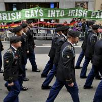 In this March 17, 2015, photo, marchers walk past a group of protesters seeking the inclusion of LGBT groups during the St. Patrick's Day Parade in New York. New York's St. Patrick's Day Parade steps off Thursday, March 17, 2016, with hopes of closing a long chapter of controversy over gay inclusion in the largest and oldest U.S. celebration of Irish heritage. | AP