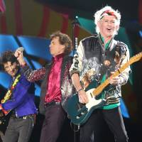 Keith Richards (right), Mick Jagger (center) and Ronnie Wood of the Rolling Stones perform in Havana on Friday.   REUTERS