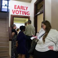 Residents wait in line to vote on Monday in Conway, Arkansas, one of a few states that participates in early election voting. | AFP-JIJI
