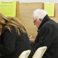 Democratic presidential candidate Sen. Bernie Sanders and his wife, Jane Sander,s vote in the Vermont primary at the Robert Miller Community and Recreation Center in Burlington Tuesday. | AP