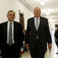 U.S. Supreme Court nominee Merrick Garland (left) is greeted by Senate Judiciary Committee ranking member Patrick Leahy on Capitol Hill in Washington Thursday. | REUTERS