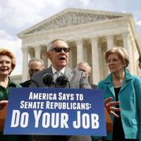 Standing in front of the U.S. Supreme Court, Senate Democratic leader Harry Reid calls for Senate Republicans to move forward with hearings for Obama's Supreme Court nominee Merrick Garland in Washington Thursday. | REUTERS