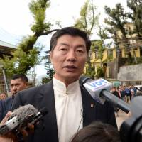 Lobsang Sangay, the Central Tibetan Administration's prime minister, is interviewed by reporters after casting his vote in leadership elections in Dharamsala, northern India, on Sunday. | AFP-JIJI
