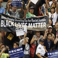 Protesters shout to stop Republican presidential candidate Donald Trump as he speaks during a campaign rally Saturday in Tucson, Arizona.   AP