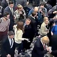 Republican Presidential candidate Donald Trump's campaign manager, Corey Lewandowski (center), is seen allegedly grabbing the arm of reporter Michelle Fields in this still frame from video taken March 8 and released by the Jupiter (Florida) Police Department Tuesday. Lewandowski, 42, was arrested in Florida on Tuesday and charged with battery, police records show. | REUTERS / JUPITER POLICE DEPARTMENT / HANDOUT VIA REUTERS